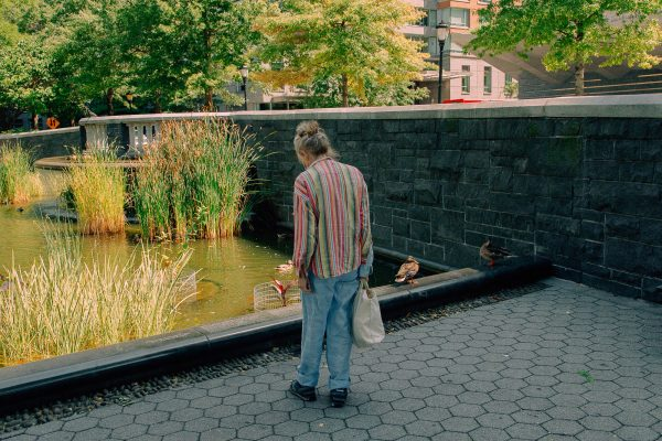 A poetry advocate reads Mark Strand's poem in Battery Park City. Photo by Daniel Terna
